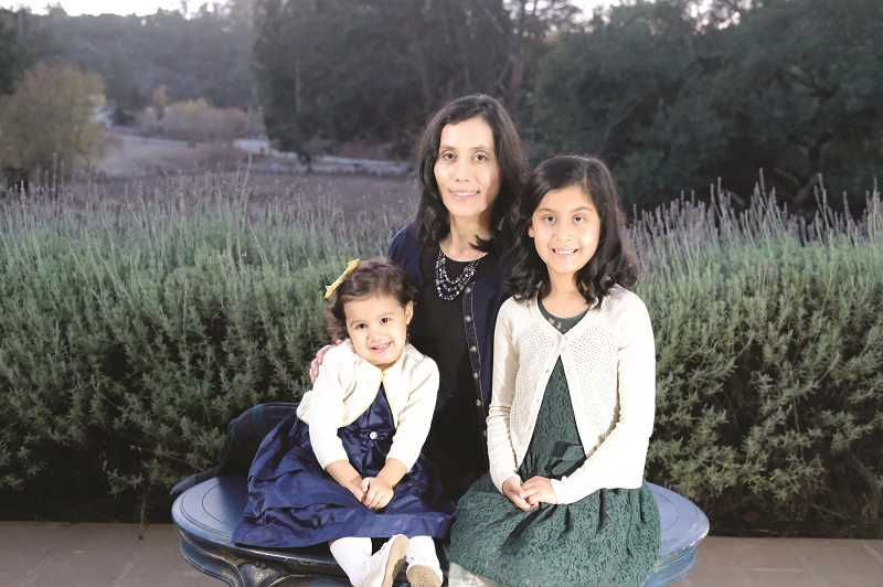 COURTESY PHOTO - Newly appointed Woodburn School Board member Noemi Legaspi cites her two daughters - Liana (left) and Isabel - as a big part of her motivation to apply for the position and stay involved in the community.