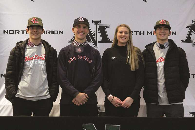 PHIL HAWKINS - From left, seniors Griffin Henry, Nic Iliyn, Paige Martin and Grant Henry signed their letters of intent to continue their athletic careers in college at a signing ceremony on Dec. 5 at North Marion High School.
