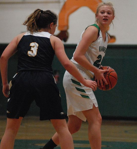ESTACADA NEWS: DAVID BALL - Estacadas Izzy Hagel looks to make a pass from the top of the key during the Rangers home loss to Stayton last week.