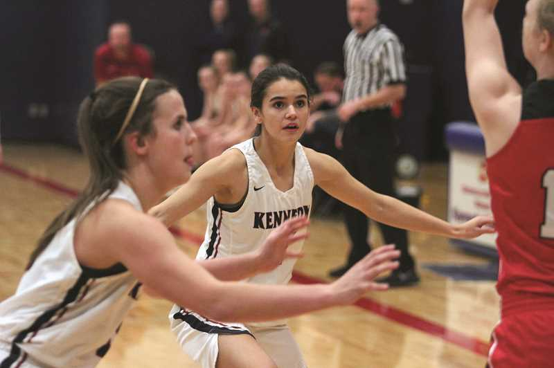 PHIL HAWKINS - Kennedy senior guard Clarissa Traeger (middle) has been a disruptive force in the backcourt for the Trojans, helping to hold opponents to just under 35 points per game this season.
