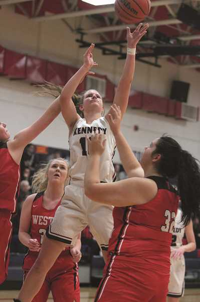 PHIL HAWKINS - After graduating seven players from last year's state championship team, the Kennedy girls basketball program has turned to seniors Kalyssa Kleinschmit (above) and Clarissa Traeger.