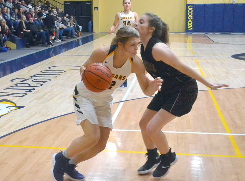 PIONEER PHOTO: TANNER RUSS - Country Christian senior Sarah Phillips had 14 points and 13 rebounds in the first match up against Damascus Christian.