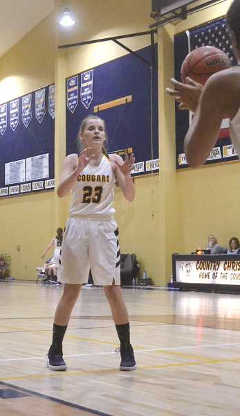 PIONEER PHOTO: TANNER RUSS - Country Christian freshman point guard Lizzy Grandle had 15 points in the game, and was able to stop the Damascus Christian center from doing big damage in the game.