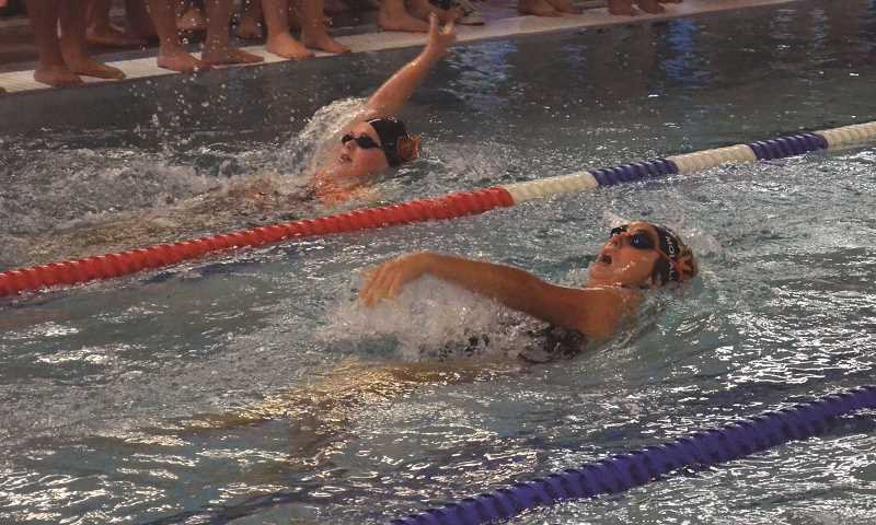 PIONEER PHOTO: TANNER RUSS - Molalla swimmers squared off with 5A Silverton on Friday, Dec. 7, and managed to take three top spots in the meet.