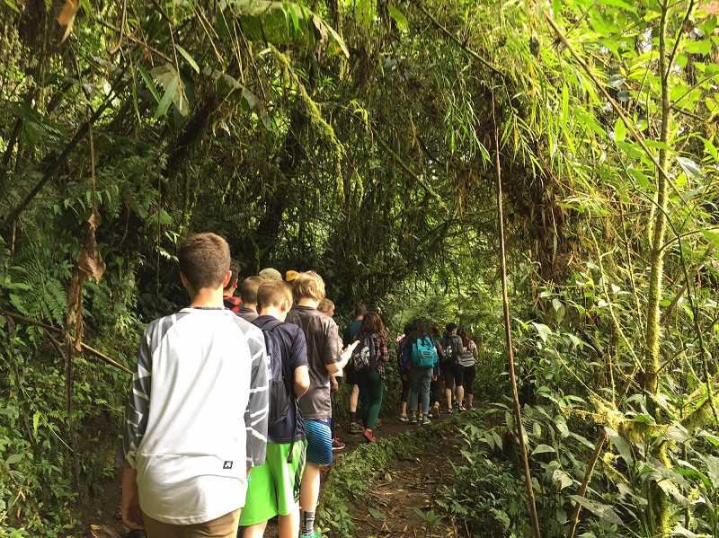 SUBMITTED PHOTO  - Students take a nature walk in the cloud forest in Costa Rica in 2016.