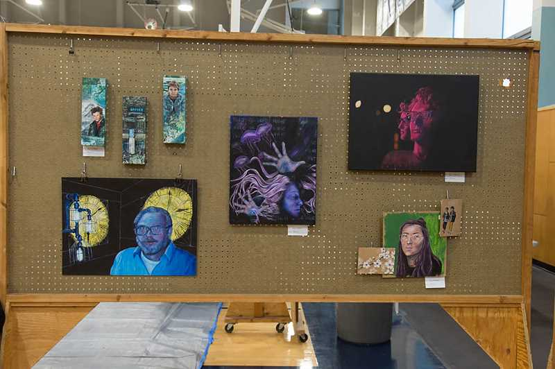 SUBMITTED PHOTO - Student artwork lines the walls at the Wilsonville Winter Festival.