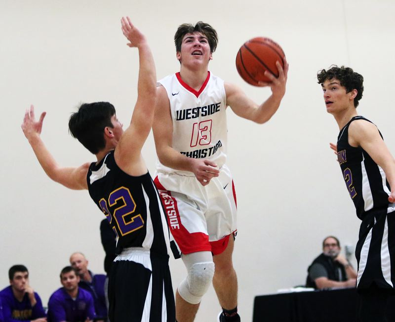 TIMES PHOTO: DAN BROOD - Westside Christian freshman Landon Thom puts up a shot during the Eagles' game with Horizon Christian on Saturday.