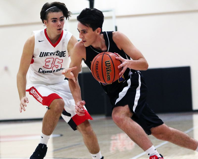 TIMES PHOTO: DAN BROOD - Horizon Christian junior Max Peterson (right) looks to drive against Westside Christian senior Max Romines during Saturday's game.