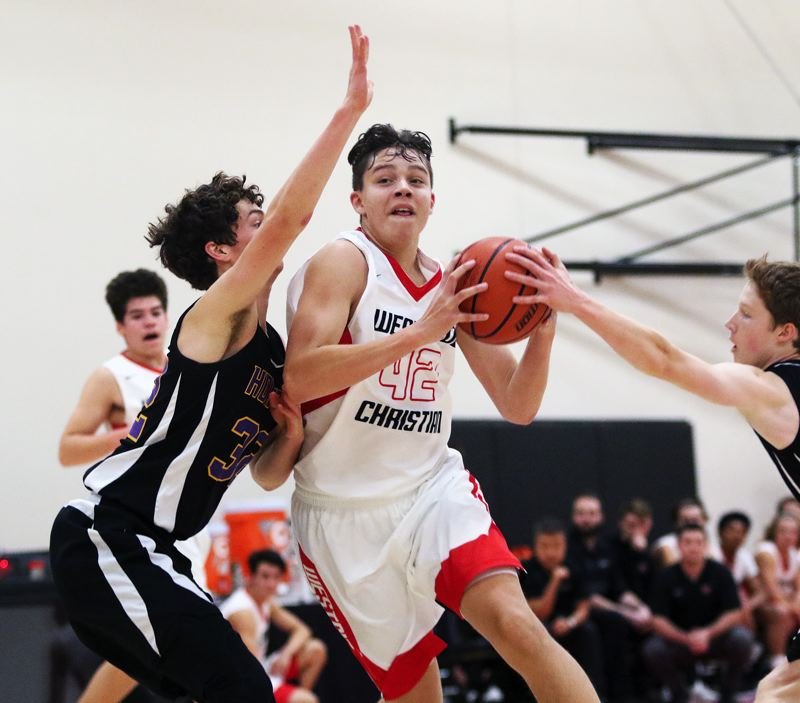 TIMES PHOTO: DAN BROOD - Westside Christian junior D.L. Scales looks to make his way to the basket during Saturday's game with Horizon Christian.