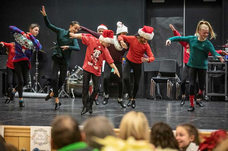 SPOKESMAN PHOTO: JONATHAN HOUSE - Members of the Innovative Dance perform during the Holiday Market at Inza R. Wood Middle School.
