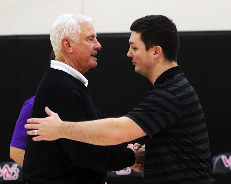 TIMES PHOTO: DAN BROOD - Horizon Christian coach Dave Brown (left) is congratulated by Westside Christian coach David Henry following Saturday's game.