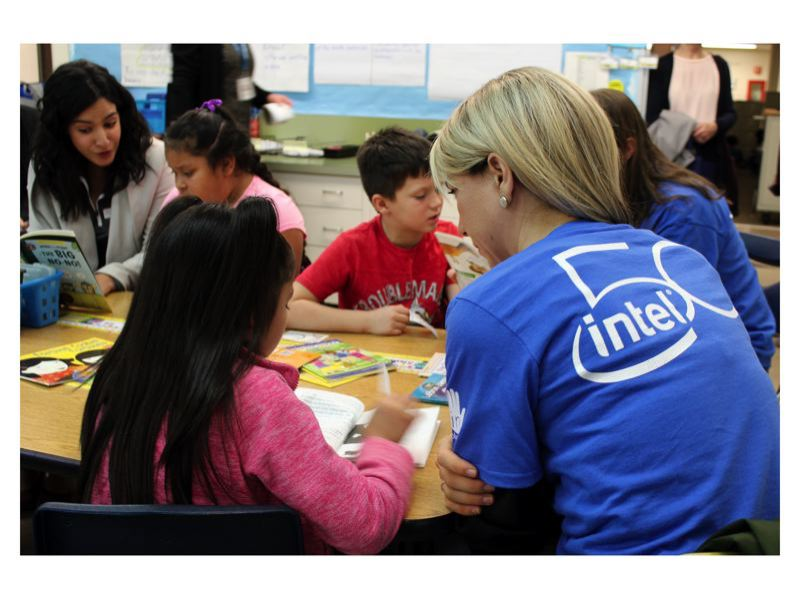 STAFF PHOTO: OLIVIA SINGER - An Intel volunteer visits an elementary school classroom in Hillsboro for a literacy program earlier this school year. Local school districts like Hillsboro and Forest Grove frequently partner with employees of Intel, Washington County's largest employer.