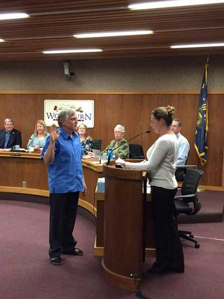 COURTESY PHOTO: WOODBURN PROUD - Eric Swenson in sworn in as Woodburn's mayor by City Recorder Heather Pierson at the Dec. 10 Woodburn City Council meeting.