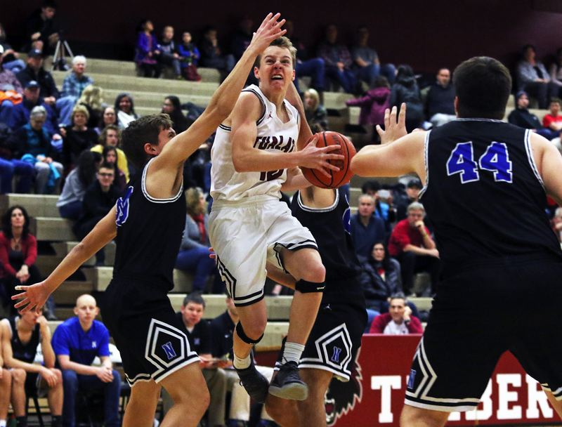 TIMES PHOTO: DAN BROOD - Tualatin senior guard Derek Levene goes up to the basket during the first quarter of the Wolves' 69-39 win over Newberg on Tuesday.
