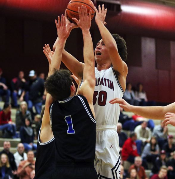 TIMES PHOTO: DAN BROOD - Tualatin senior post Bridger Steppe (right) had 14 points and 11 rebounds in the 69-39 win over Newberg.