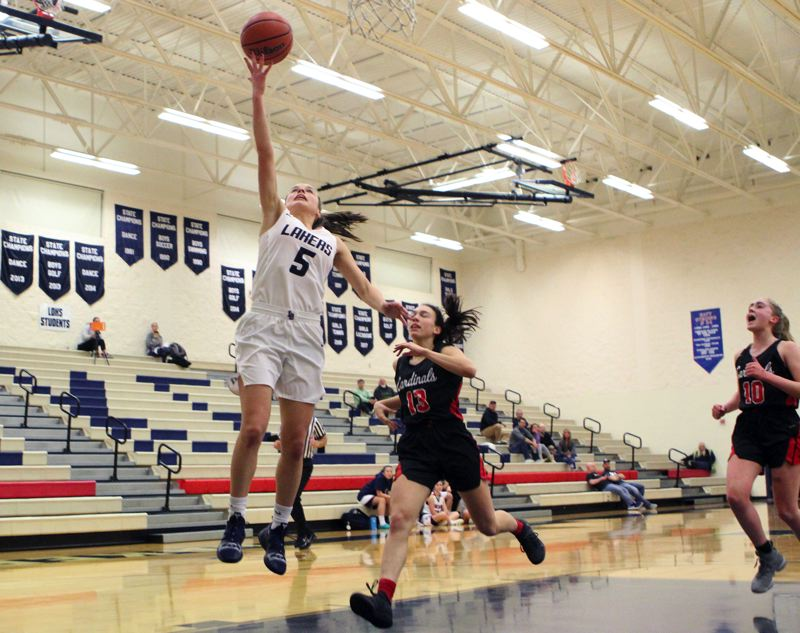 REVIEW PHOTO: MILES VANCE - Lake Oswego senior guard Katy Gilbert goes up for a layup during her team's 47-34 win over Lincoln at Lake Oswego High School on Tuesday.