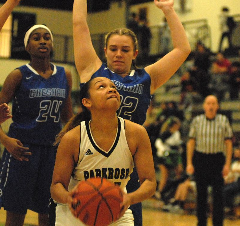 OUTLOOK PHOTO: DAVID BALL - Imani Royster of Parkrose looks to go up to the hoop while Greshams Grace Williams provides the defense.
