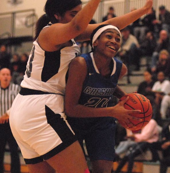 OUTLOOK PHOTO: DAVID BALL - Greshams Destiny Ogbeama fights her way to the basket on a drive in the first half.