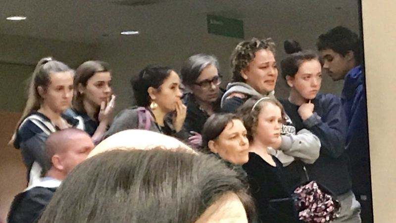 TRIBUNE PHOTO: SHASTA KEARNS MOORE - Jefferson High School senior Sarah Steele stands crying in a cluster of students as the board votes for a second time Tuesday, Dec. 11, on a police cost-sharing agreement. Behind her in glasses is Jefferson High School Principal Margaret Calvert.