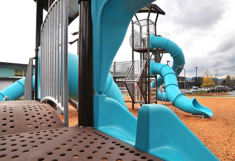 GARY ALLEN - A new playground opened Nov. 17 at Babe Nicklous Pool Park, featuring tall play structures and ADA amenities.