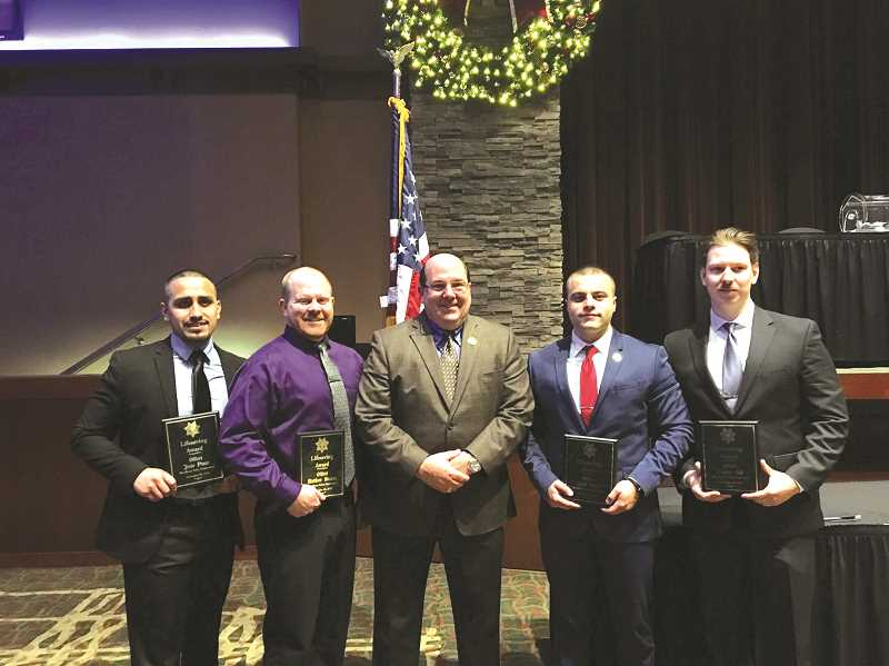 COURTESY PHOTO: CITY OF WOODBURN - Woodburn Police Department Chief Jim Ferraris (center) stands with members of his department who received Lifesaving Awards from the Oregon Peace Officers Association. They are (from left) Jesse Ponce, Matt Stearns, Jacob Stout and Charlie Gill.