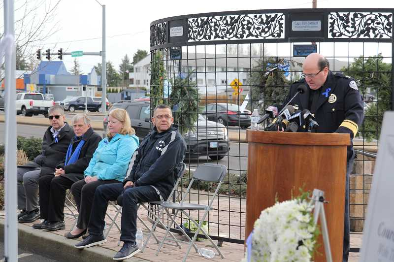 PHIL HAWKINS - Woodburn Police Chief Jim Ferraris opens the ceremony Wednesday commemorating the sacrifices made 10 years ago in the wake of the West Coast Bank bombing.