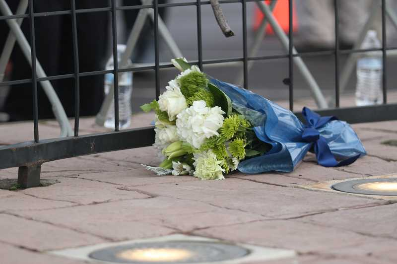 PHIL HAWKINS - A bouquet of flowers was placed on the memorial commemorating those who were killed and wounded in the Woodburn West Coast Bank bombing 10 years ago.