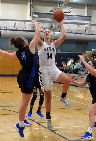 SPOKESMAN PHOTO: TANNER RUSS - Sophomore Emilia Bishop a big threat in the paint, collecting rebounds and sinking buckets to help the team overcome Churchill.