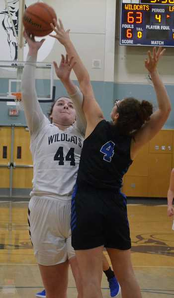 SPOKESMAN PHOTO: TANNER RUSS - Senior Hannah McKinney was able to get boards that kept Wilsonville comfortably in the lead.