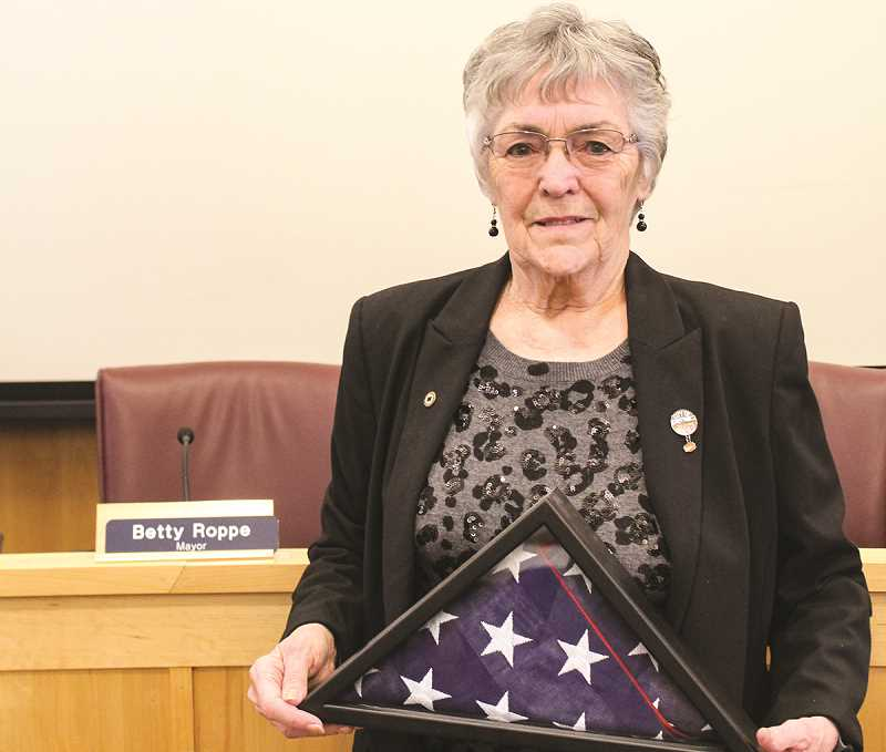 JASON CHANEY/CENTRAL OREGONIAN  - Prineville Mayor Betty Roppe poses for a photo in the City Council Chambers holding an American flag given to her by U.S. Sen. Jeff Merkley.
