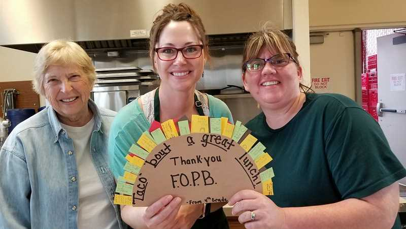 PHOTO COURTESY OF KATHY EBY  - Powell Butte Community Charter School fourth-graders made a thank-you note for the kitchen crew. From left, Kathy Eby, Dalene Maykut and Bethany Auld.