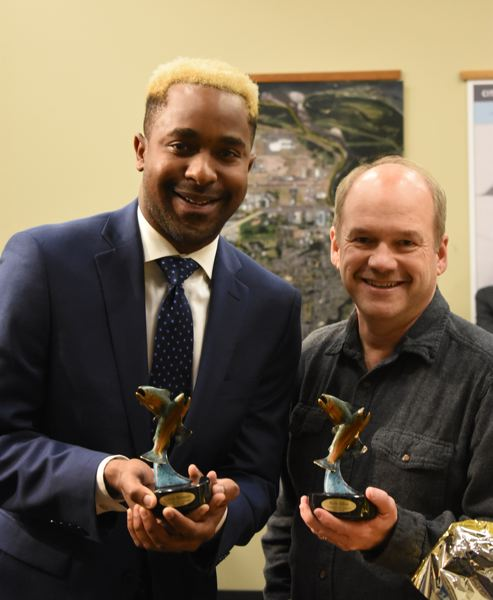OUTLOOK PHOTO: MATT DEBOW  - Outgoing councilors Rich Allen and Larry Morgan hold their parting gifts from the city of Troutdale on Tuesday, Dec. 11. The city gave them small statues as a token of their service.