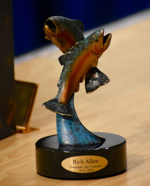 OUTLOOK PHOTO: MATT DEBOW  - The city presents small statues of fish jumping as a token of Rich Allens and Larry Morgans service.
