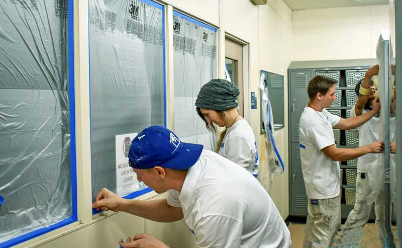 SUBMITTED PHOTO - JK Paint & Contracting workers prepare the Newberg High girls locker room for a fresh coat of paint.