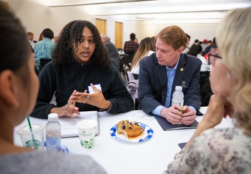 PAMPLIN MEDIA GROUP FILE PHOTO - Portland high school student Lydia Wade-Sully chats with Oregon legislators, including state Sen. Tim Knopp, right, during a town hall hosted in early 2018 by the Joint Legislation Committee on School Success.