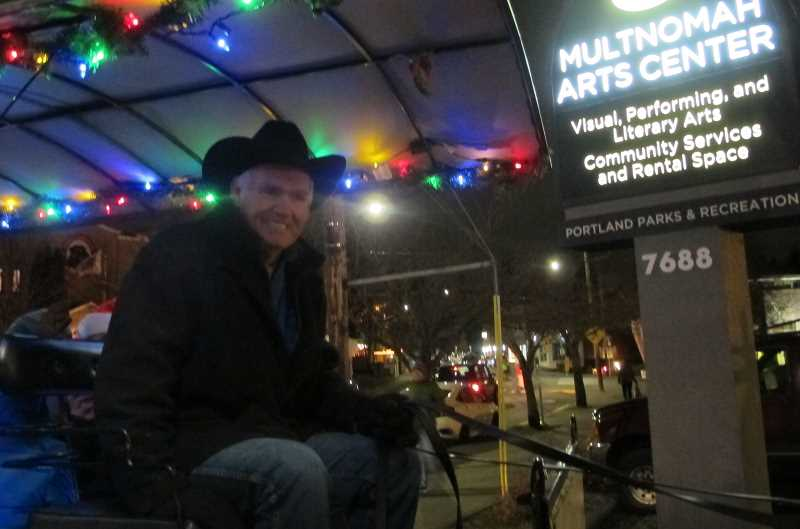 "Larry Chafin, also of Sweet Home, says he's been bringing his horses and carriage to Multnomah Village ""for the last eight or nine years"" and enjoys the Holiday Gala.  ""Two weeks ago we were in Lake Oswego for the tree lighting.  We go all over this time of year,"" said Chafin.  For most of the evening there was a line of 75 to 100 adults and children waiting to ride his carriage"