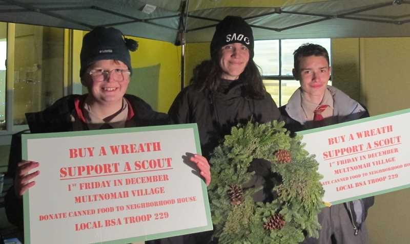 Members of Boy Scout Troop 229, which meets  at West Portland United Methodist, set up shop in front of Neighborhood House on Capitol Highway.  Dylan Platt, center, says the wreath sale is their main fund raiser each year.  The Boy Scouts sold wreaths until 10PM.