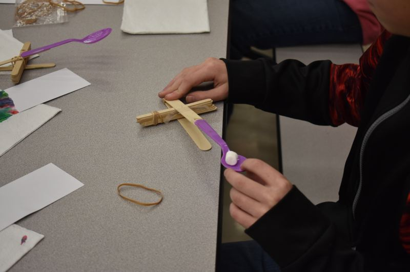 OUTLOOK PHOTO: TERESA CARSON - Mitchell Denman readies his catapult for launch.