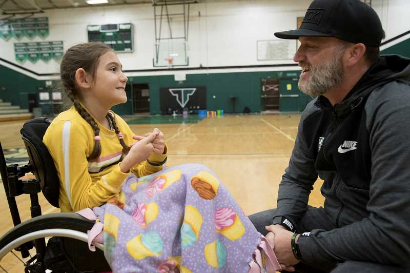 TIMES STAFF: JAIME VALDEZ - Mya Muckey, 9-1/2, third grader at Archer Glen Elementary School, talks with Cory Burket, a Black Rock Coffee Bar franchisee, before being announced as this years Sparrow during Tigard High Schools assembly on Friday.
