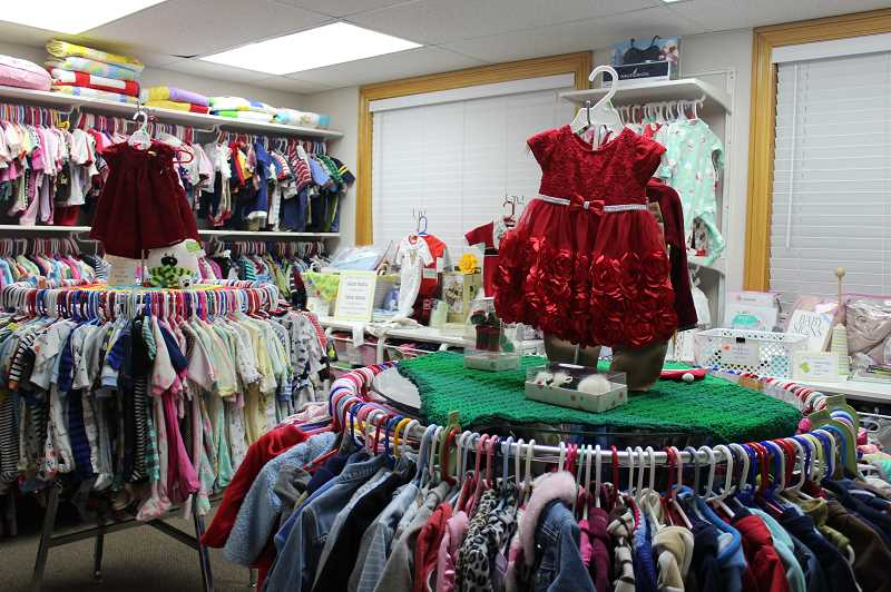 PAMPLIN PHOTO: KRISTEN WOHLERS - The center's baby boutique is stocked with used and new items, including some holiday wear.