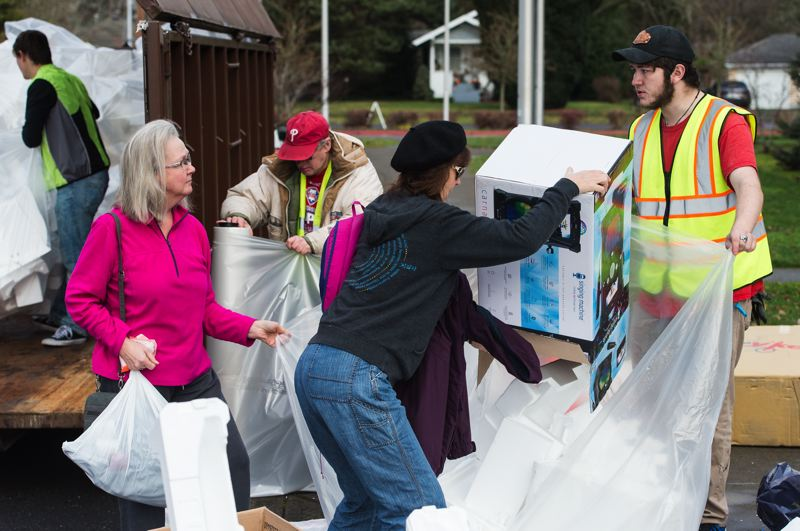 STAFF PHOTO: CHRISTOPHER OERTELL - Recyclers brought styrofoam to recycle during the PlanetCon event at Lincoln Street Elementary School on Jan. 6. The next PlanetCon will be held at Quatama Elementary School next month.