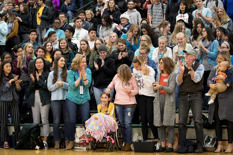 TIMES PHOTO: JAIME VALDEZ - Mya Muckey smiles after being recognized as this year's Sparrow for Tigard High. Mya has suffered her entire life from the effects of spina bifida.