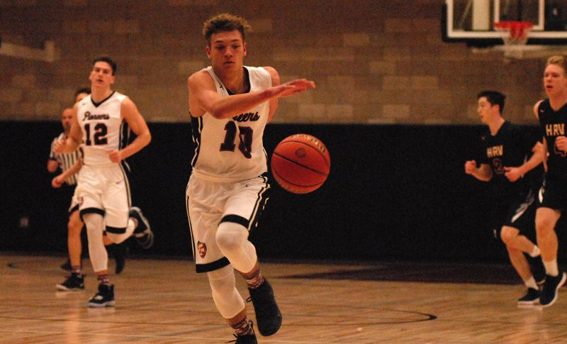 SANDY POST: DAVID BALL - Sandys Pierce Roeder chases a loose ball into the backcourt. He finished with a game-high 22 points in Wednesdays 88-68 home win over Hood River.
