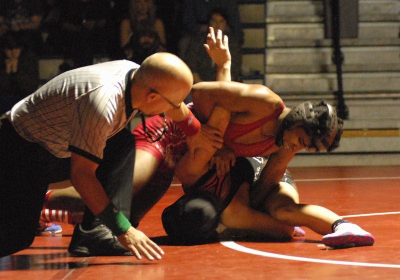 OUTLOOK PHOTO: DAVID BALL - Centennials Mufezul Yusun works to finish off a pin with 0:08 left in the 126-pound bout Thursday against Sandy.
