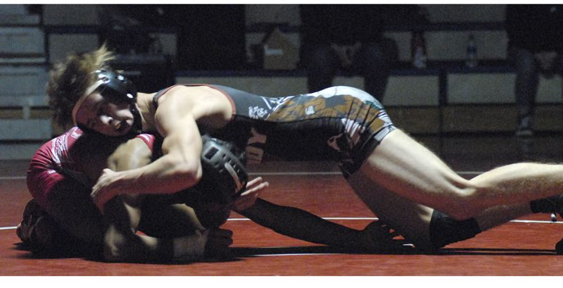 SANDY POST: DAVID BALL - Sandys Colby Giltner stretches out on his way to a 13-8 decision at 132 pounds.
