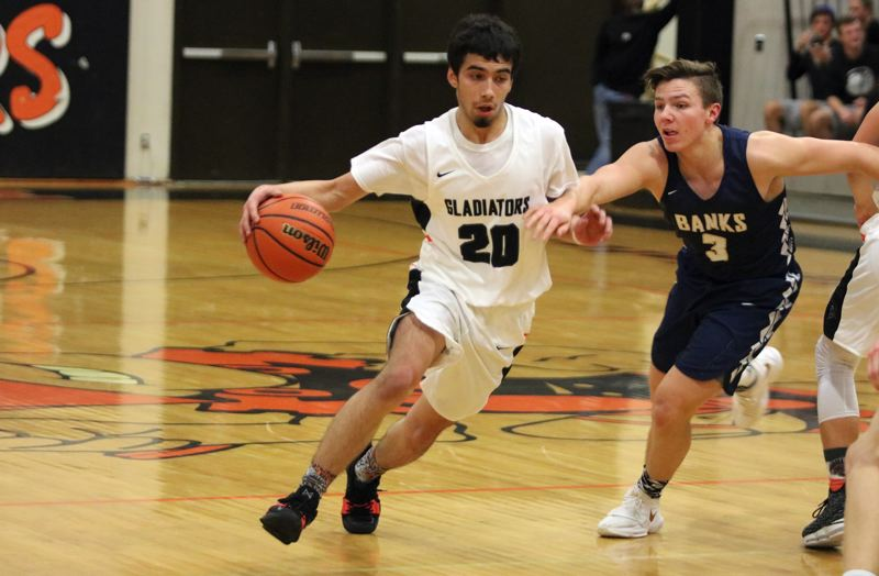 PAMPLIN MEDIA: JIM BESEDA - Gladstone's Damian Zaines (20) drives around Banks' Dakota Bunn (3) during the first half of Friday's non-conference boys' basketball game at Gladstone High School. Banks won 62-60 in OT.
