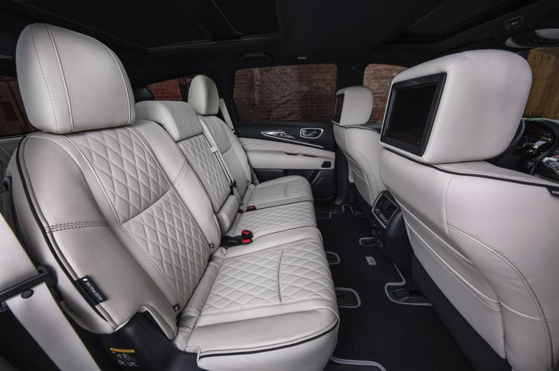 COURTESY INFINITI MOTOR CO. - The second rown of seats in the 2019 Infiniti QX60 can carry three adults in comfort (shown here with the optional Theater Package).