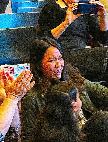 DAVID F. ASHTON - Whitman Elementary School first grade teacher Janet Do – shown at the moment she realized that SHE's the teacher being presented a $25,000 Milken Educator Award.