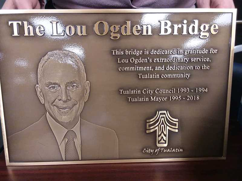 TIMES PHOTO: RAY PITZ - This is the bronze plaque that will be installed on a bridge namee in honor of Tualatin Mayor Lou Ogden. The Myslony Bridge will be dedicate during a grand opening ceremony set for 9 a.m. Thursday, Dec. 20, at the bridge.