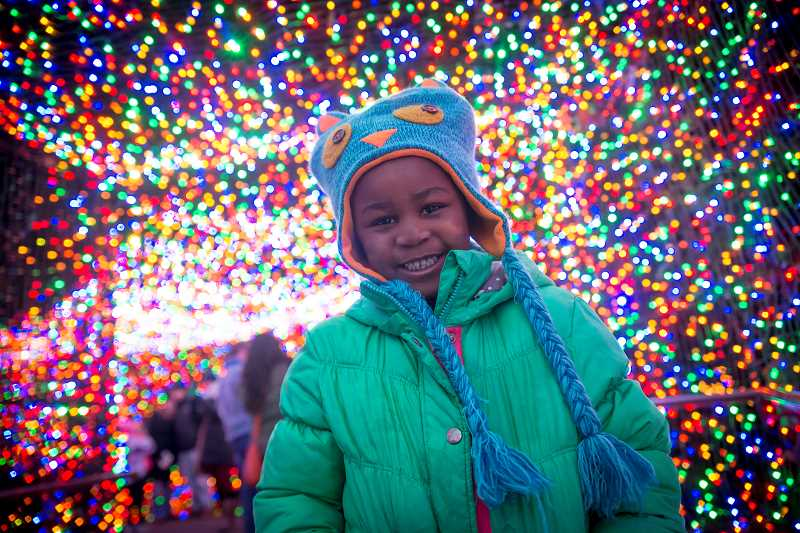 COURTESY PHOTO: OREGON ZOO - Five-year-old Jocelyn Twig enjoying Zoolights at the Oregon Zoo.